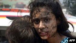 Пешавардағы шіркеуге қарсы жарылыстардан зардап шеккендер. Пәкістан, 22 қыркүйек 2013 жыл.