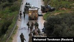 ისრაელის ჯარისკაცები ინციდენტის ადგილას მიდიან. რამალა, ისრაელის მიერ ოკუპირებული დასავლეთი ნაპირი, 4 მარტი, 2019 წელი.