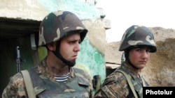 Armenian soldiers on a front-line position near Nagorno-Karabakh, where fighting broke out one week ago.