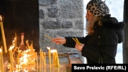 A member of the Serbian Orthodox Church attends a service during Orthodox Christmas Eve celebrations in Cetinje, Montenegro, January 6. The Montenegrin Orthodox Church also held an event in the town on the same day just a few hundred meters away.