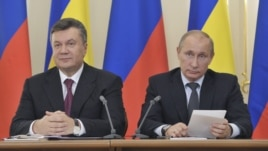 Yanukovych (left) and Putin meeting in Moscow in October, 2012.