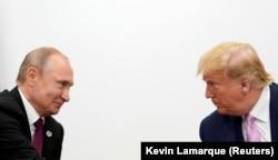 Vladimir Putin și Donald Trump, în marginea conferinței G20 din Osaka, Japonia, 28 iunie 2019