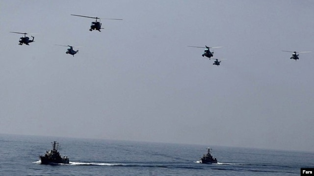"Iranian helicopters and war-boats during ""Velayat-90"" navy exercises in the Strait of Hormuz (file photo)"