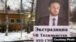 Tajiks protested in December in front of the UAE Embassy in Moscow against the arrest of opposition leader Umarali Quvatov, shown on placard, in Dubai.