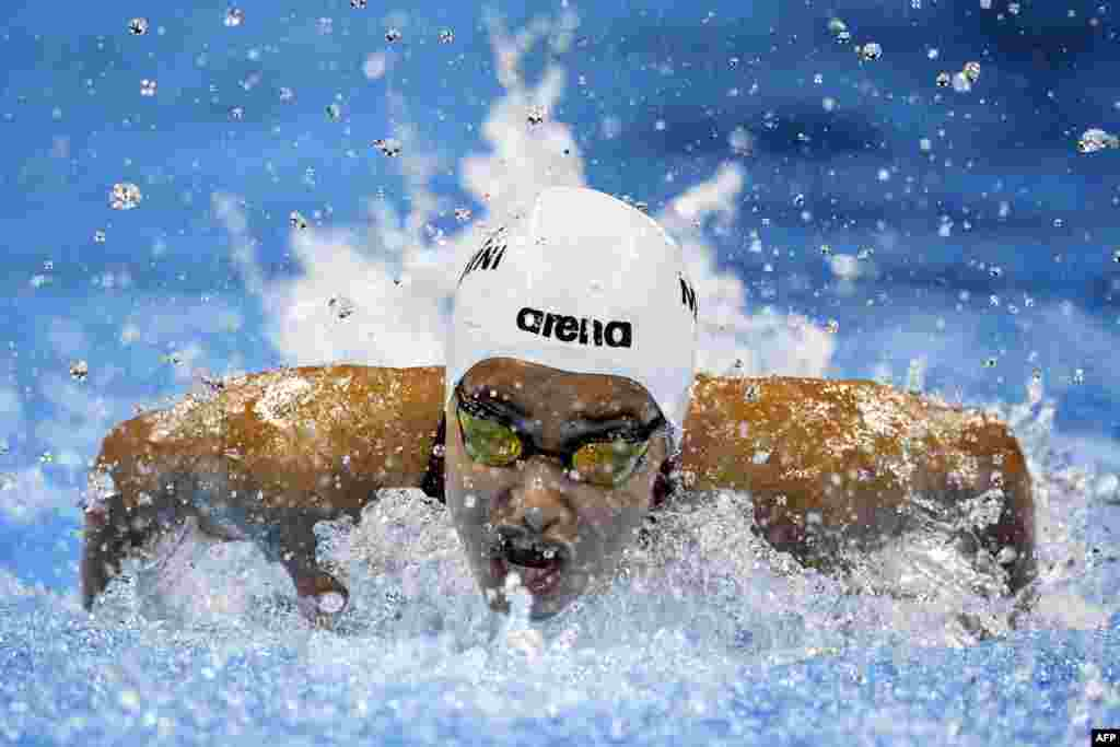 The Refugee Olympic Team's Yusra Mardini takes part in the Women's 100-meter butterfly heat during the swimming event at the Rio 2016 Olympic Games at the Olympic Aquatics Stadium in Rio de Janeiro on August 6. (AFP/Martin Bureau)