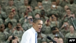 "U.S. President Barack Obama addresses troops at Fort Campbell, Kentucky, on May 6, after he met and decorated the ""full assault force"" behind the clandestine raid that killed Osama bin Laden, the most sought-after terrorist in U.S. history, earlier that m"