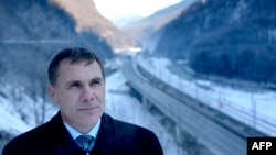 Environmental Watch activist Yevgeny Vitishko stands in front of the new road between Adler and Krasnaya Polyana in the Black Sea resort of Sochi.