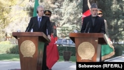 Italian Prime Minister Mario Monti (left) appears at a Kabul press conference on November 4 with Afghan President Hamid Karzai.