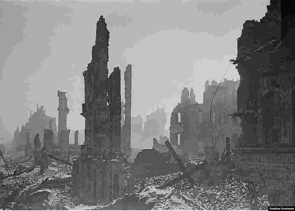 """Stumps of buildings stand in Dresden's city center. A British prisoner of war who was in the city during the firebombing recalled that while charred adult bodies could be seen throughout the rubble, there was little left of the children because """"their bones were too tender and they just melted."""""""
