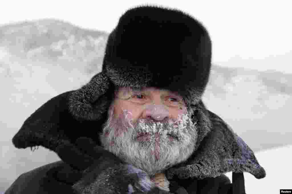 Boris Lezhnin, 75, walks along an embankment of the Yenisei River in the Russian city of Divnogorsk, south of the Siberian city of Krasnoyarsk, in temperatures of around minus 30 degrees Celsius. Lezhnin said he goes on his evening walks in any weather. (Reuters/Ilya Naymushin)
