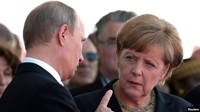 Russian President Vladimir Putin talks with German Chancellor Angela Merkel in June