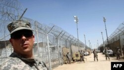 U.S. soldiers guard Camp Bucca on the outskirts of Basra.