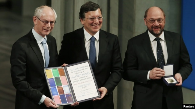 (Left to right): The president of the European Council Herman Van Rompuy, the president of the European Commission Jose Manuel Barroso, and the president of the European Parliament Martin Schulz collect the Nobel Peace Prize on behalf of the EU in Oslo on December 10.