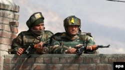Indian soldiers take position during fighting earlier this year against Pakistani militants in Kashmir.
