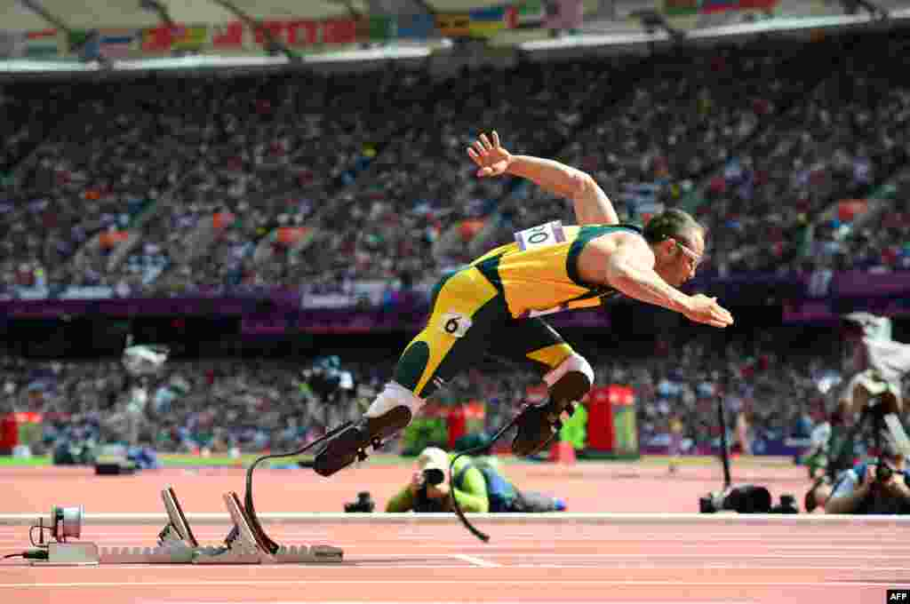 South Africa's Oscar Pistorius became the first ever double-leg amputeeto compete at an Olympic Games when he raced in the 400-meter heats of the track-and-field program in August. Pistorious also took part in the Paralympics a month later, winning three medals. (AFP/Oliver Morin)