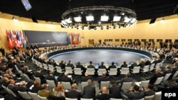 Portugal -- General view of delegates attending a working session on the second day of the NATO Summit in Lisbon, 20Nov2010