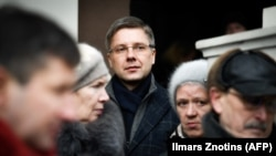 Nils Usakovs attends a rally in front of Riga City Hall on February 9.