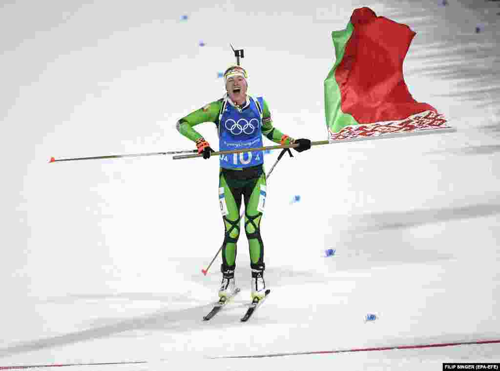 Biathlon: Darya Domracheva of Belarus celebrates winning the Women's Biathlon 4 x 6 km Relay race at the Alpensia Biathlon Centre during the PyeongChang 2018 Olympic Games, South Korea, February 22, 2018.