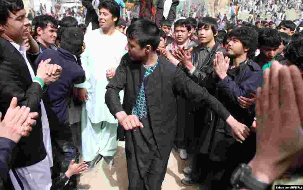 Kabul men dance with each other as part of the Norouz celebrations.