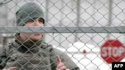 Kyrgyzstan -- A US soldier guards the main access checkpoint to the US Manas air base, 04Feb2009