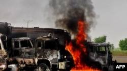 Trucks carrying fuel for NATO forces in Afghanistan burn following an attack by militants southeast of Quetta on October 9.