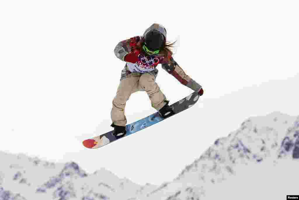 Winner Jamie Anderson of the United States jumps during the women's snowboard slopestyle finals event in Rosa Khutor.