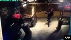 A gunman carrying out an attack on the Reina nightclub in Istanbul as seen in footage from a closed-circuit television camera.