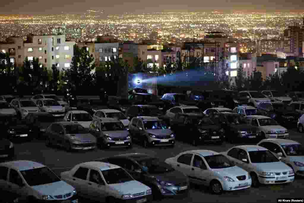 The screening of a classic Iranian film plays to a car-bound crowd in Tehran on May 3.