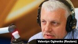 Белорусский оппозиционный журналист Павел Шеремет.