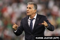 "The team's veteran Portuguese coach, Carlos Queiroz, has vowed that Iran will ""not go to Russia as tourists."""