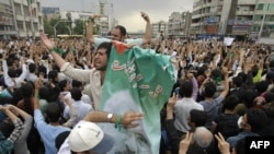 Musavi supporters rally in Tehran, the first time a defeated candidate has refused to accept defeat in Iran.
