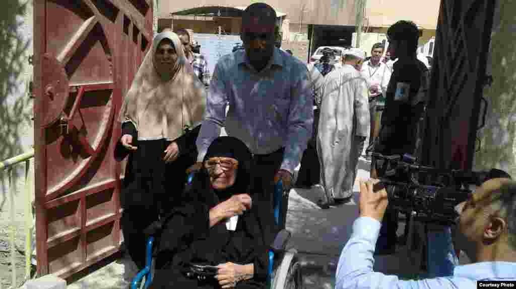 A group of voters arrives to cast their ballots in Basra.