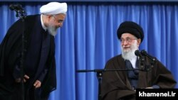 President Hassan Rouhani (L) and Supreme Leader Ali Khamenei. File photo