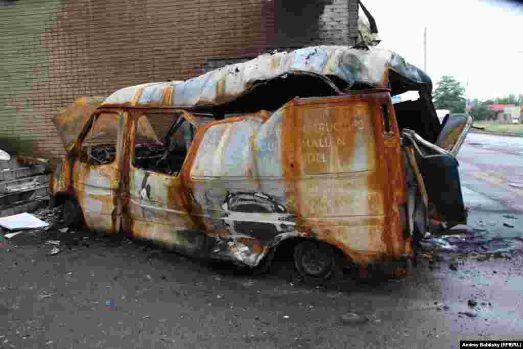 A minivan destroyed by fire.