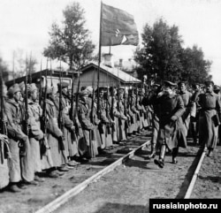 Red Army commander Leon Trotsky salutes soldiers near today's St. Petersburg in 1919.