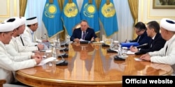 Kazakh President Nursultan Nazarbaev (center) made his remarks on Islamic garb while meeting with the country's religious leaders in the capital, Astana, on April 19.