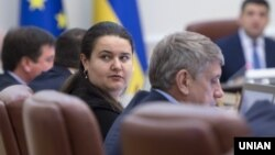 The continued presence of some key economic officials from the previous government, such as Finance Minister Oksana Markarova, which will help ensure some policy stability, Fitch said.