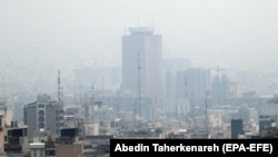 A general view shows smog obscures buildings in Tehran, December 5, 2018