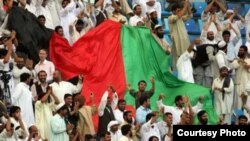 Fans unfurl an Afghan flag at a cricket qualifier in Dubai in February.
