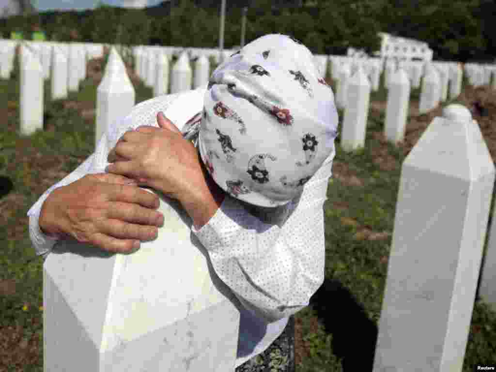 Adila Suljakovic cries at the grave of her son in the Memorial Center in Potocari, near Srebrenica. Tens of thousands of family members, foreign dignitaries, and guests are expected to attend a ceremony in Srebrenica on July 11 marking the 16th anniversary of the massacre, in which Bosnian Serb forces commanded by Ratko Mladic killed up to 8,000 Muslim men and boys.Photo by Dado Ruvic for Reuters