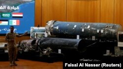 A Saudi-led coalition spokesman, Colonel Turki al-Malki, displays missiles he said were manufactured by Iran during a news conference in Riyadh this week.