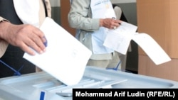 The new law will keep in place the Electoral Complaints Commission, which was integral to unmasking massive fraud during Afghanistan's last presidential election in 2009.