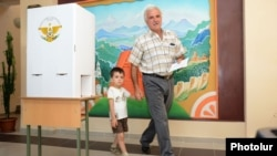 Nagorno-Karabakh - A many votes at a polling station in Stepanakert, 19Jul2012.