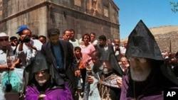 Iranian Armenian Christians gather at the Qareh Kelisa (Black Church) in Dasht-E-Chalran, 373 miles (600 kilometers) northwest of the Iranian capital, Tehran, on Saturday, July 29, 2000. Archbishop Nurvan Zakarian from France, right, Jasliq Aram First, se