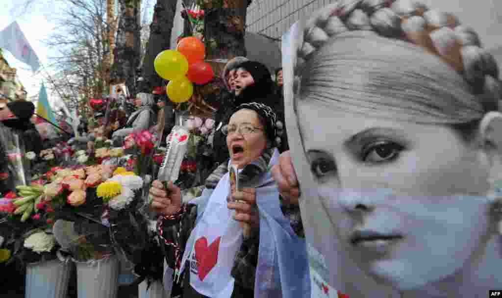 Marking Tymoshenko's 51st birthday, a supporter holds her portrait during a rally in front of a Kyiv prison on November 27, 2011.
