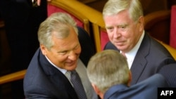 EU envoys Aleksander Kwasniewski (left) and Pat Cox (right) during a visit to Kyiv in September