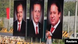 Պակիստանի նախագահ Մամնուն Հուսեյնի, Թուրքիայի նախագահ Ռեջեփ Էրդողանի և Պակիստանի վարչապետ Նավազ Շարիֆի մեծադիր դիմանկարները Իսլամաբադում՝ Էրդողանի այցին ընդառաջ, 16-ը նոյեմբերի, 2016թ․