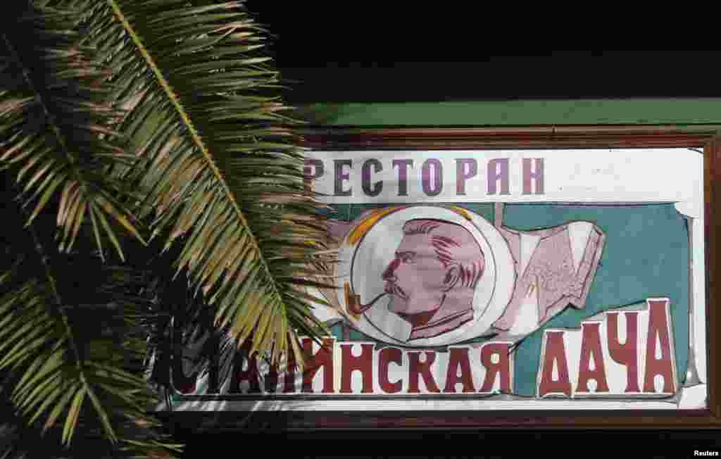 "A sign advertising the ""Stalin's Dacha"" restaurant"