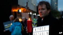 Richard Ratcliffe husband of imprisoned charity worker Nazanin Zaghari-Ratcliffe, poses for the media during an Amnesty International led vigil outside the Iranian Embassy in London, Monday, Jan. 16, 2017. Charity worker Zaghari-Ratcliffe was jailed in Ir