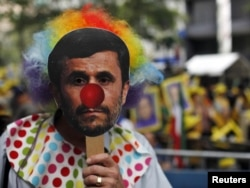 "A protester wears a mask depicting Iranian President Mahmud Ahmadinejad rallies outside UN headquarters in New York in September 2011, where he said that ""arrogant powers"" threatened anyone who questioned the Holocaust. Many diplomats walked out."